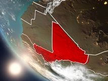 Sunset above Mali from space. Illustration of Mali as seen from Earth's orbit during sunset with visible country borders. 3D illustration. Elements of this Stock Photos