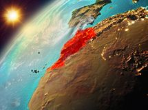 Morocco on planet Earth in sunset. Illustration of Morocco as seen from Earth's orbit during sunset. 3D illustration. Elements of this image furnished by stock photo