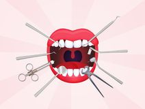 Mouth open with dentist tools Royalty Free Stock Photography
