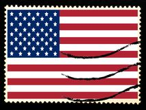 Illustration of national flag of United States of America on vintage postage stamp on black background. Old paper texture.  Royalty Free Stock Photos