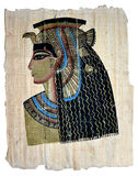 Queen Cleopatra on Egyptian Papyrus. Illustration on papyrus in golden metallic and vintage colors Stock Photo