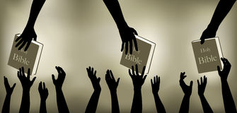 Hands Reaching Out for Bibles Stock Photo
