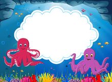 The ocean view with the cloud board blank space and two big octopus with a little fish