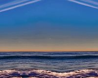 Illustration of the ocean wave at sunset, unusual clouds and waves. royalty free illustration