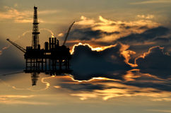 Illustration of oil platform on sea and sunset Stock Photo