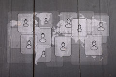 Illustration of people on white world map on black wooden background Stock Photography