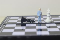 Free Illustration Photo Concept, 1 Businessman Mini Figure Toy Help To Winning War Or Battle Small Magnetic Plastic Royalty Free Stock Photography - 166303157
