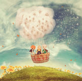 Children in a balloon on a glade Royalty Free Stock Images