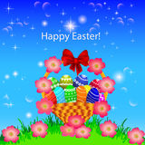 Of a postcard in the Easter basket of eggs flower Royalty Free Stock Photo