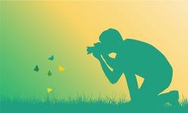 Illustration réaliste d'un jeune homme photographiant la butte de vol Image libre de droits