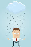 Rain cloud over businessman Royalty Free Stock Images