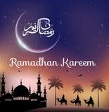 Ramadan kareem with walking camel caravan at night day Royalty Free Stock Photo