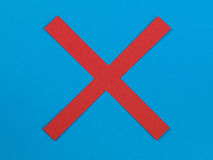 Illustration of a Red Cross on a Blue Background Stock Images