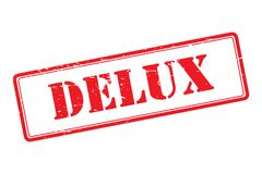 Delux rubber stamp. An illustration of a red rubber stamp with the text 'Delux Royalty Free Stock Photography