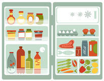 Open refrigerator full of food and drinks Stock Photo