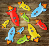 Illustration of Rockets on Wooden Background Royalty Free Stock Images