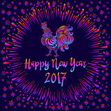 Illustration of a rooster with spread wings colored rainbow colors on a dark background. Below the colored text 2017 Happy new yea. R art Royalty Free Stock Image