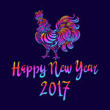 Illustration of a rooster with spread wings colored rainbow colors on a dark background. Below the colored text 2017 Happy new year art Royalty Free Illustration