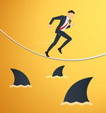 Illustration of a running businessman on rope with sharks underneath business risk chance. EPS10 royalty free illustration