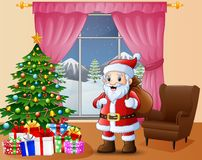 Santa bringing sack in the living room with christmas and new year decoration Stock Image