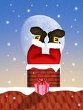 Santa Claus in the fireplace Royalty Free Stock Photo