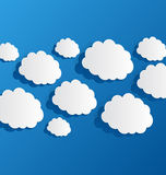 Set cut out clouds, blue paper Stock Photo