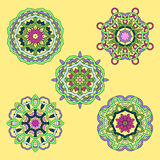 Illustration of set from five abstract ornament. Illustration of set from five round abstract ornament on yellow background. Ornate mandalas Stock Image