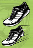Illustration with a set of running shoes on a green football field Stock Photo