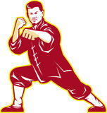 Shaolin Kung Fu Martial Arts Master Retro. Illustration of shaolin kung fu martial arts karate master in fighting stance with temple and sunburst in background Royalty Free Stock Photos