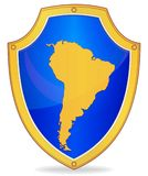 Shield with silhouette of South America Royalty Free Stock Images