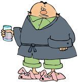 Sick man wearing a robe and slippers stock image