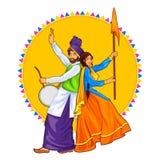 Sikh Punjabi Sardar couple playing dhol and dancing bhangra on holiday like Lohri or Vaisakhi Stock Photos