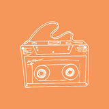 Illustration. Sketch. Orange background with music cassette. Royalty Free Stock Photography