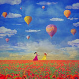 Illustration    of small girls  with  colorful hot air balloons Royalty Free Stock Images