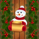 Snowman with gift box and festive decoration. Illustration of snowman with gift box, holly leaves and berries, fir tree branches and wood background Stock Photos
