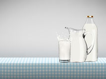 Illustration of splashing organic milk in transparent glass, bottle and jug standing on a table covered by blue checkered napkin Stock Image