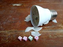Photo Illustration, Stuck Idea, text from plastic alphabet bead and broken small led bulb stock illustration