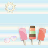 Three popsicles on striped background Royalty Free Stock Photo