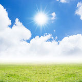 Sunny skies over green field. An illustration of a sunny sky over green grassy field Stock Photo