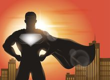 Superhero Standing with Cape Waving in the Wind Silhouette. Illustration of superhero silhouette with cityscape background Royalty Free Stock Image
