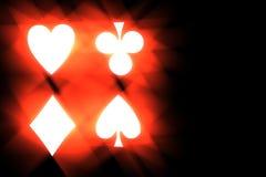 Illustration symbols stylized playing cards. On a black background Stock Image