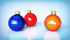 Christmas decoration. Three multicolored Christmas balls. Illustration of of three colorful balls with rings and stars on blue background with reflection stock illustration
