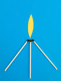 Illustration of Three Lit Matches Against a Blue Background Stock Images