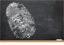 Illustration of a Thumb Print on a Chalk Board Royalty Free Stock Images