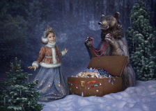 Illustration to a fairy tale 12 months Marshak. Fancy girl with a bear in the winter forest Royalty Free Illustration