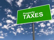 "Property taxes. An illustration of a traffic sign with the text ""property taxes Stock Photography"