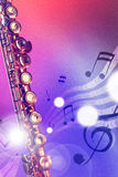 Illustration transverse flute with red and blue lights vertical. Conceptual illustration transverse flute with flying notes, brightness and red and blue lights Royalty Free Stock Photography