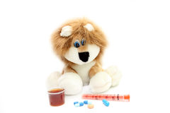 Illustration of treatment of children. A soft toy and medical preparations Stock Image