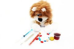Illustration of treatment of children. A soft toy and medical preparations Royalty Free Stock Photos