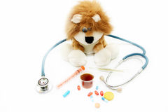 Illustration of treatment of children. A soft toy and medical preparations Royalty Free Stock Photography